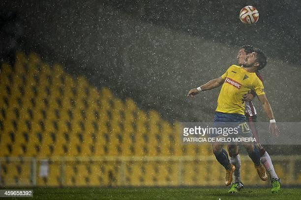 Estoril's midfielder Antonio Jose Toze Carvalho vies with PSV Eindhoven's Spanish midfielder Andres Guardado during the UEFA Europa League Group E...