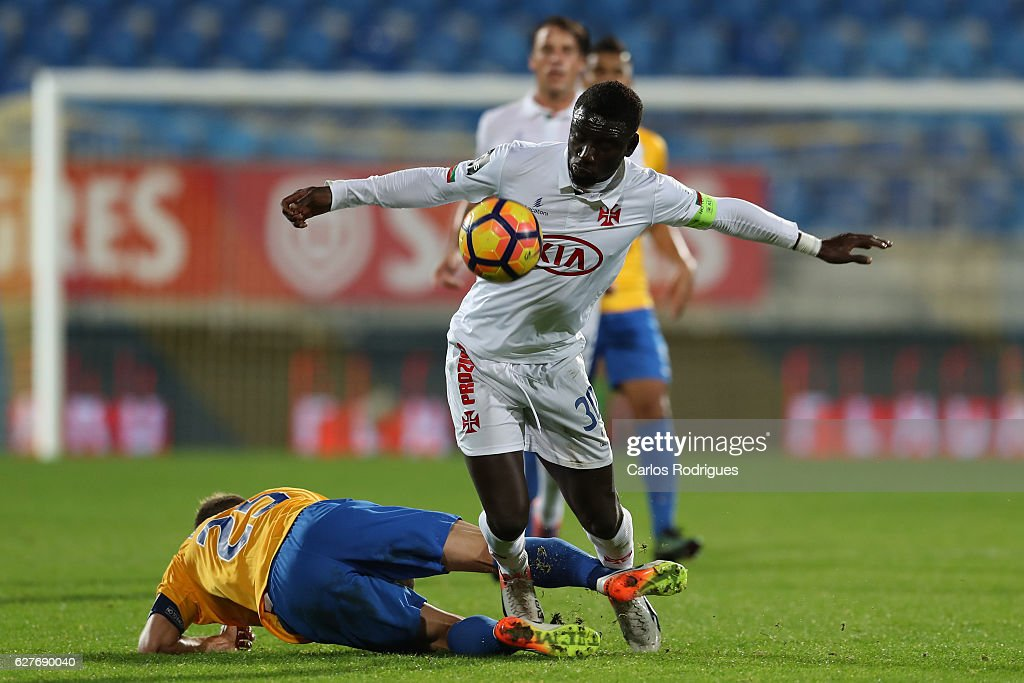 Estoril's midfielder Diogo Amado from Portugal (L) tackles Belenenses's forward Gerso from Portugal (R) during the match between Estoril Praia SAD and CF Os Belenenses for the Portuguese Primeira Liga at Estadio Antonio Coimbra da Mota on August 21, 2016 in Lisbon, Portugal.