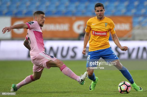 Estoril's midfielder Eduardo Teixeira from Brazil with Chaves's forward Pedro Tiba from Portugal in action during the Primeira Liga match between GD...