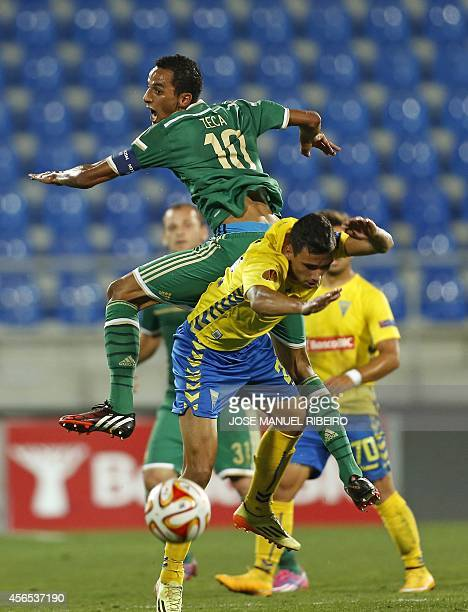 Estoril's midfielder Emidio Rafael vies with Panathinaikos Portuguese midfielder Zeca during the UEFA Europa League Group E football match Estoril...