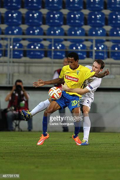 Estoril's midfielder Kuca vies with Dynamo Moscow's defender Aleksey Kozlov during the Europa League match between Estoril Praia v FC Dinamo Moskva...