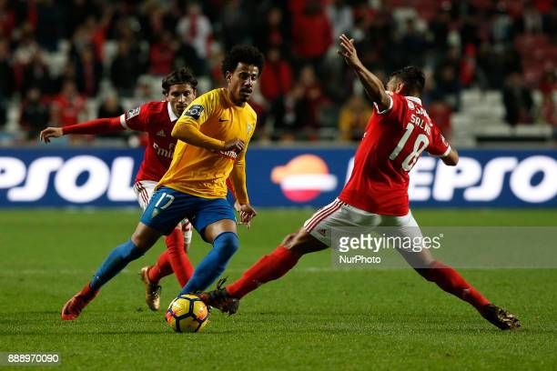 Estoril's midfielder Lucas Evangelista vies for the ball with Benfica's midfielder Filip Krovinovic and Benfica's forward Eduardo Salvio during...