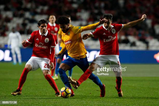 Estoril's midfielder Lucas Evangelista vies for the ball with Benfica's midfielder Filip Krovinovic and Benfica's forward Jonas during Primeira Liga...