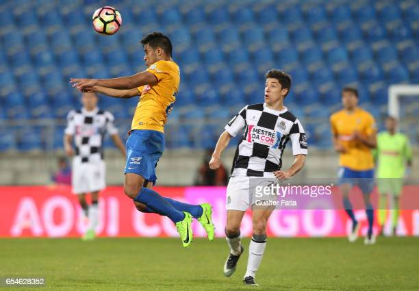 Estoril's midfielder Matheus Indio from Brazil with Boavista's defender Edu Machado from Portugal in action during the Primeira Liga match between GD...