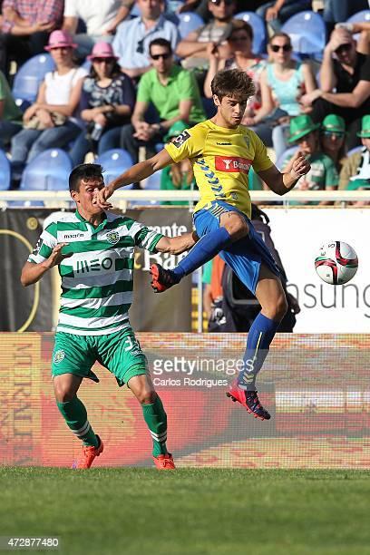 Estoril's midfielder Matias Cabrera vies with Sporting's defender Jonathan Silva during the Prmeira Liga match between Estoril and Sporting CP at...