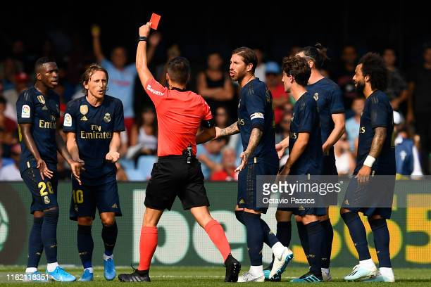 Estrada Fernandez the referee shows a red card for Luka Modric of Real Madrid during the Liga match between RC Celta de Vigo and Real Madrid CF at...