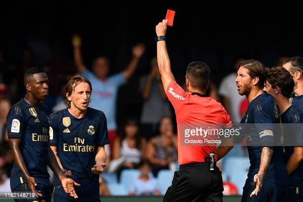 Estrada Fernandez, the referee, shows a red card to Luka Modric of Real Madrid during the Liga match between RC Celta de Vigo and Real Madrid CF at...