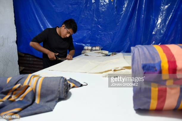 Estuardo Perez cuts cloth inspired in Mayan costumes to make cotton bags in an attempt to put a curb on the abuse of plastic usage in Perez Guizasola...