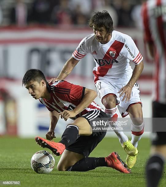 Estudiantes de La Plata's midfielder Joaquin Correa vies for the ball with River Plate's midfielder Leonardo Ponzio during their Copa Sudamericana...