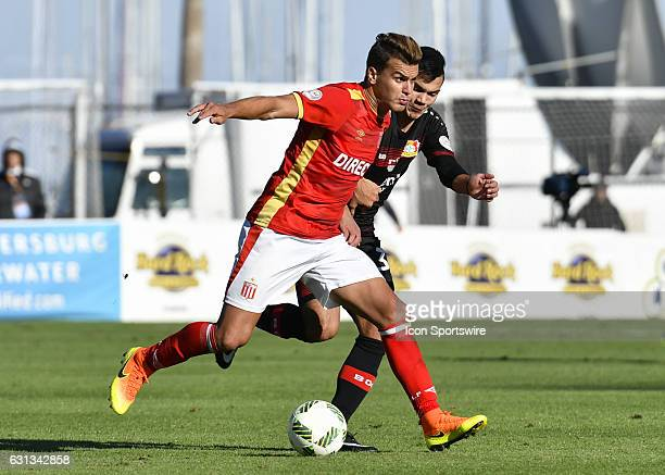 Estudiantes defender Eandro Gonzalez Pirez holds off Bayer 04 Leverkusen midfielder Atakan Akkaynak during the first half of the Florida Cup between...