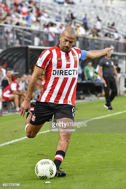 Estudiantes midfielder Juan Sebastian Veron takes a free kick during the first half of the Florida Cup game between Bahia and Estudiantes on January...