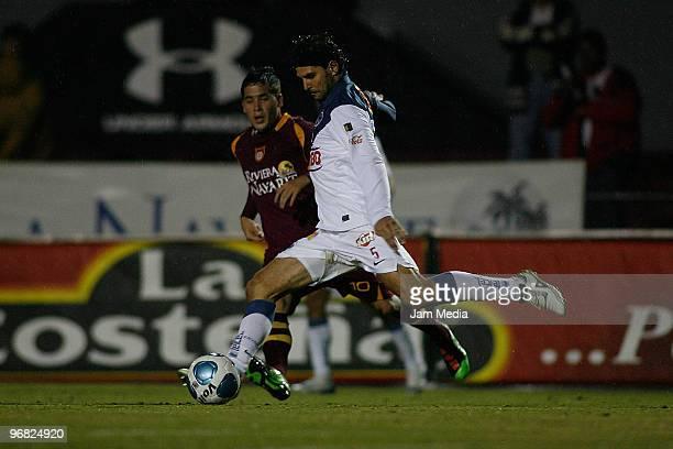 Estudiantes Tecos' player Mauro Cejas vies for the ball with Monterrey's player Duilio Davino during their match in the Bicentenario 2010 tournament,...