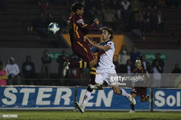 Estudiantes Tecos' player Samuel Ochoa vies for the ball with Monterrey' player Jose Maria Basanta during their match in the Bicentenario 2010...