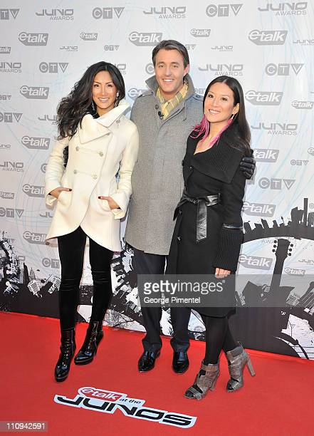 etalk hosts Tanya Kim Ben Mulroney and Elaine 'Lainey' Lui pose on the red carpet at the 2011 Juno Awards at Air Canada Centre on March 27 2011 in...