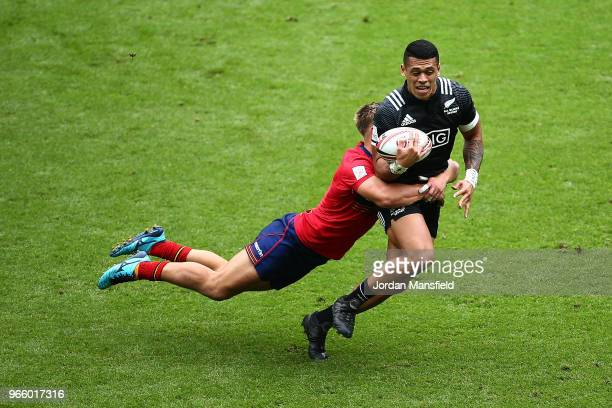 Etene NanaiSeturo of New Zealand is tackled by Harvey Elms of Scotland on day one of the HSBC London Sevens at Twickenham Stadium on June 2 2018 in...