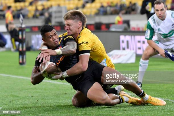 Etene Nanai-Seturo of the Chiefs is tackled by Jordie Barrett of the Hurricanes during the round four Super Rugby Aotearoa match between the...