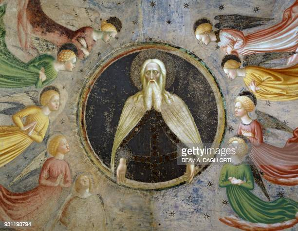 Eternal father surrounded by angels fresco by Masolino da Panicale from Stories of St John Baptist vault of Baptistery of Castiglione Olona Lombardy...