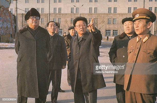 Eternal President of the Republic Kim Ilsung with his son Kim Jongil on a building site