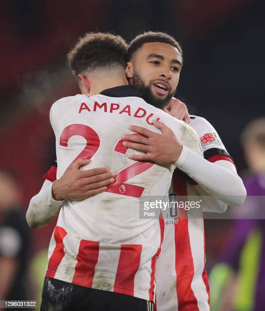 Ethan Ampadu and Jayden Bogle of Sheffield United celebrate following their sides victory in the Premier League match between Sheffield United and...