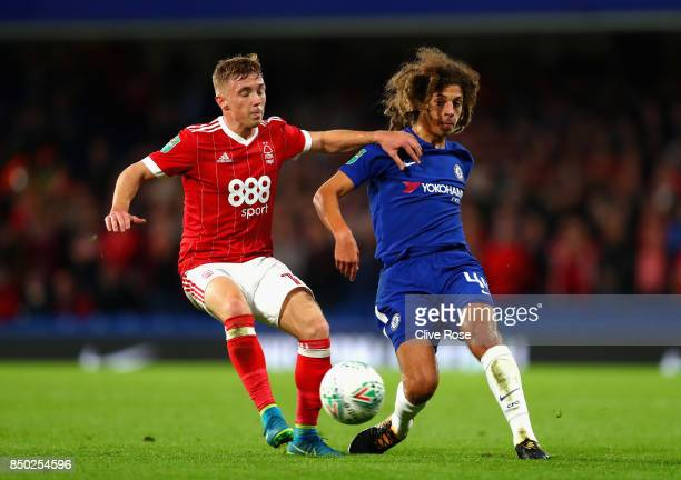 Ethan Ampadu of Chelsea attempts to get past Ben Osborn of Nottingham Forest during the Carabao Cup Third Round match between Chelsea and Nottingham...