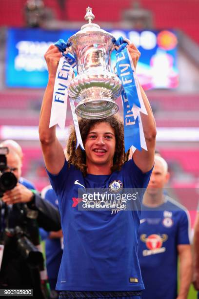Ethan Ampadu of Chelsea celebrates with the FA Cup trophy after the Emirates FA Cup Final between Chelsea and Manchester United at Wembley Stadium on...