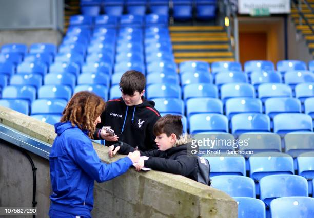Ethan Ampadu of Chelsea FC signs autographs ahead of the Premier League match between Crystal Palace and Chelsea FC at Selhurst Park on December 30...