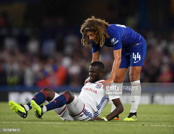 Ethan Ampadu of Chelsea helps Tanguy NDombele Alvaro of Lyon during the preseason friendly match between Chelsea and Lyon at Stamford Bridge on...