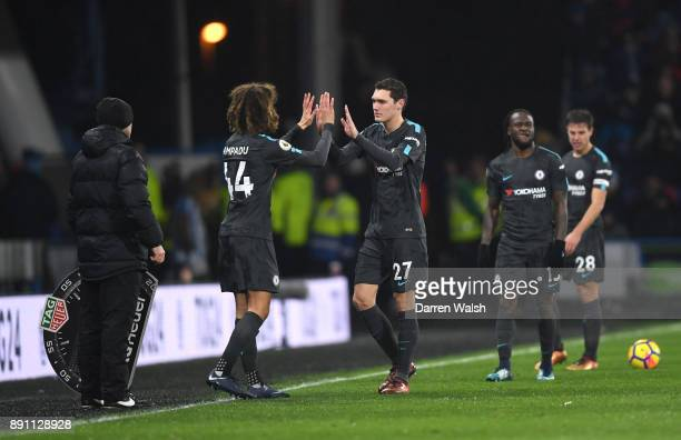 Ethan Ampadu of Chelsea high fives Andreas Christensen of Chelsea as he comes on to make his premier league debut during the Premier League match...