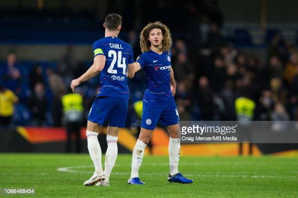 Ethan Ampadu of Chelsea shakes hands with team mate Gary Cahill of Chelsea after the UEFA Europa League Group L match between Chelsea and PAOK at...