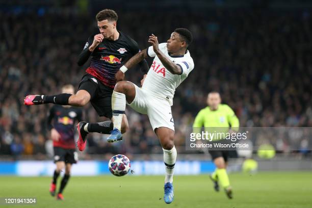 Ethan Ampadu of RB Leipzig battles with Steven Bergwijn of Spurs during the UEFA Champions League round of 16 first leg match between Tottenham...
