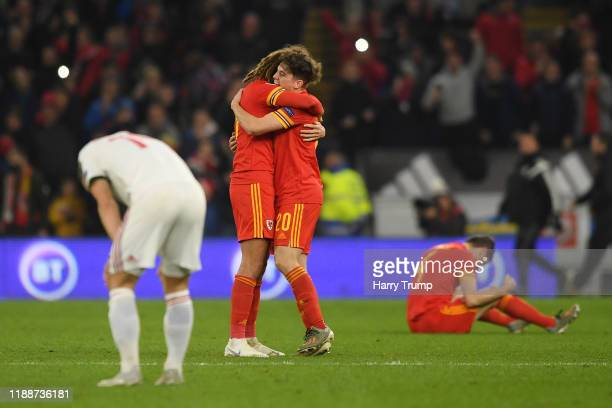 Ethan Ampadu of Wales and Daniel James of Wales celebrate at the final whistle during the UEFA Euro 2020 qualifier between Wales and Hungary so at...