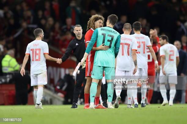 Ethan Ampadu of Wales and Kepa Arrizabalaga of Spain at full time of the International Friendly match between Wales and Spain on October 11 2018 in...