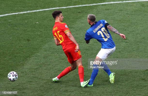 Ethan Ampadu of Wales fouls Federico Bernardeschi of Italy, a challenge he is then awarded a red card for during the UEFA Euro 2020 Championship...