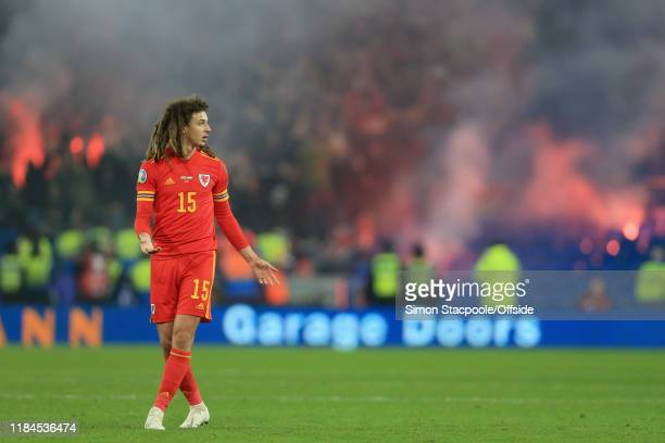 Ethan Ampadu of Wales looks on as flares and smoke go off in the background during the UEFA Euro 2020 Qualifier between Wales and Hungary at Cardiff...