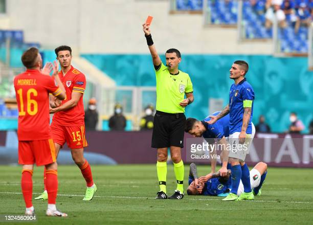 Ethan Ampadu of Wales reacts as he is shown a red card by Match Referee, Ovidiu Hategan during the UEFA Euro 2020 Championship Group A match between...