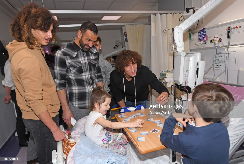 Ethan Ampdau, Edwardo and David Luiz of Chelsea during the Chelsea and Westminster Hospital Visit on December 7, 2017 in London, England.