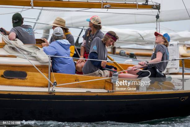 Ethan Andrus winches in the jib following a tack during the start sequence while his cousin Emma Conover tails during the Eggemoggin Reach Regatta in...