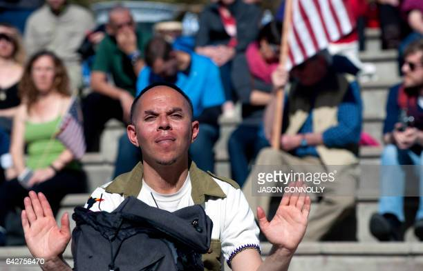 Ethan Au Green listens to speakers at the Civic Center Park in Denver Colorado on February 18 2017 before marching to the First Unitarian Church...