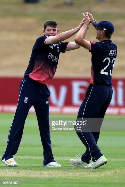 Ethan Bamber and Will Jacks of England celebrate the dismissal of Mohammad Tawhid Hridoy of Bangladesh during the ICC U19 Cricket World Cup match...