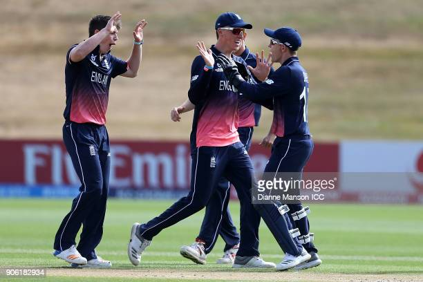 Ethan Bamber of England and team mates celebrate the dismissal of Mohammed Saif Hassan of Bangladesh during the ICC U19 Cricket World Cup match...