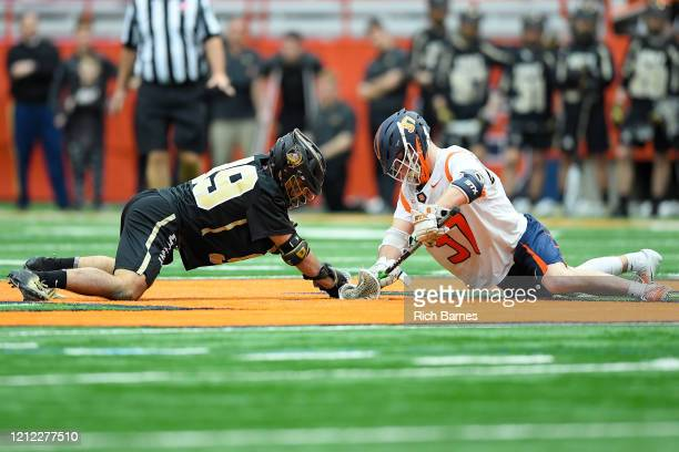 Ethan Barangan of the Army Black Knights and Jakob Phaup of the Syracuse Orange battle during a face-off during the second half at the Carrier Dome...