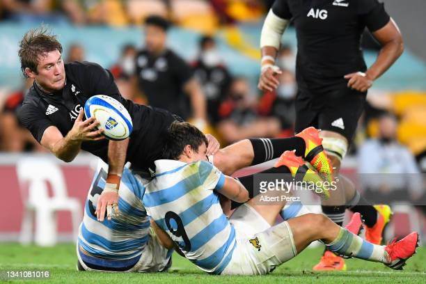 Ethan Blackadder of the All Blacks offloads the ball in a tackle during The Rugby Championship match between the Argentina Pumas and the New Zealand...