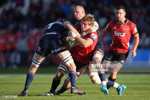 Ethan Blackadder of the Crusaders is tackled during the round 8 Super Rugby match between the Crusaders and Brumbies at Christchurch Stadium on April...