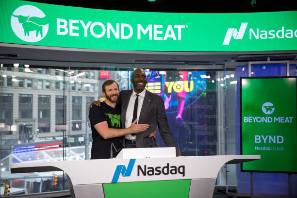 Ethan Brown, founder and chief executive officer of Beyond Meat Inc., left, and John Salley, a former professional basketball player with the...