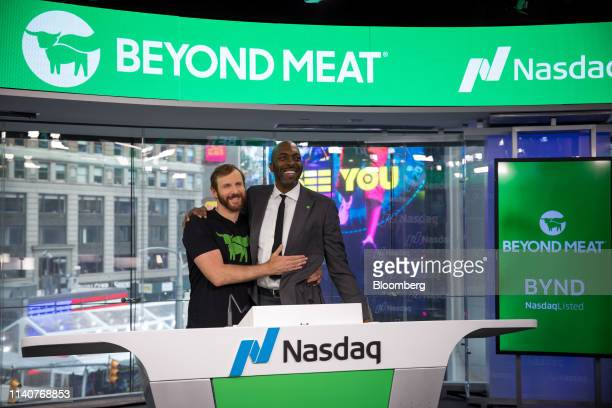 Ethan Brown founder and chief executive officer of Beyond Meat Inc left and John Salley a former professional basketball player with the National...