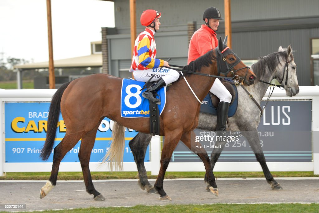 Ethan Brown returns to the mounting yard on Starvasive after winning Sportsbet BM58 Handicap at Racing.com Park Synthetic Racecourse on August 22, 2017 in Pakenham, Australia.