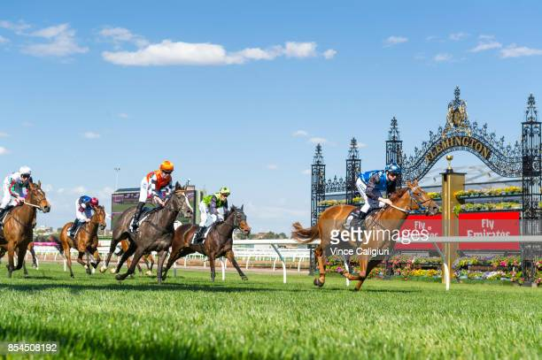 Ethan Brown riding Divine Messenger wins Race 4 during Melbourne Racing at Flemington Racecourse on September 27 2017 in Melbourne Australia