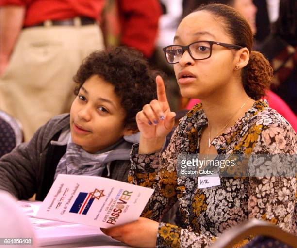 Ethan Cheek left and his sister Alize Cabral during the 12th annual Cape VerdeanJewish Passover Seder at the Hibernian Hall in the Roxbury...