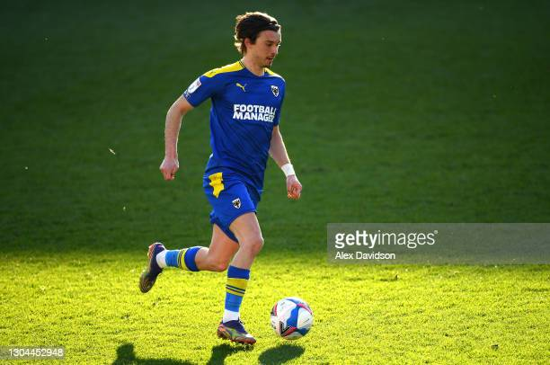 Ethan Chislett of AFC Wimbledon runs with the ball during the Sky Bet League One match between AFC Wimbledon and Hull City at Plough Lane on February...