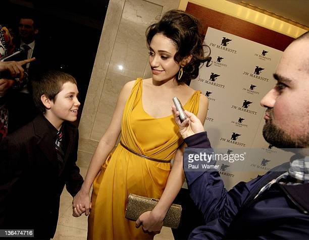 Ethan Cutkosky and Emmy Rossum attend the grand opening of the JW Marriott Chicago on March 7 2011 in Chicago Illinois